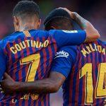 coutinho y malcom celebran un gol con el barcelona